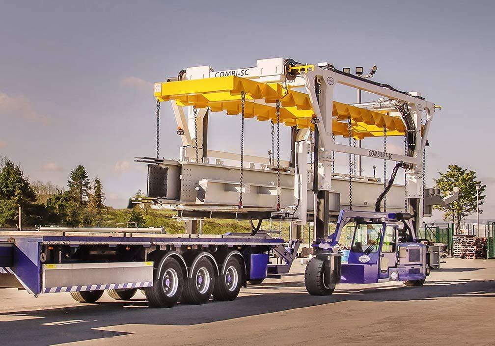straddle-Carrier-loading-a-stack-of-steel--landscape